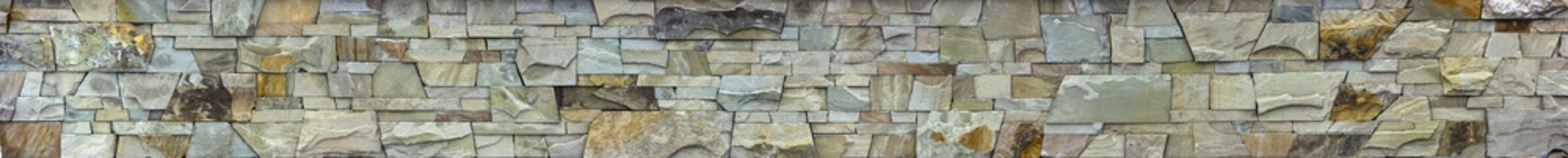 Texture of a gray stone wall, panorama.