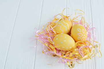 Easter eggs painted in pastel colors on a white background