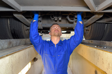 diesel mechanic fixing a vehicle