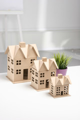 Miniature houses on the desk in office