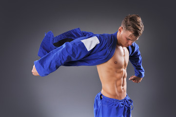 Portrait of Handsome Muscular Jiu Jitsu Fighter Posing. Concept of Healthy Lifestyle.