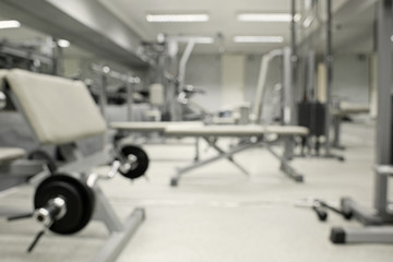 Gym interior with equipment, blurred background