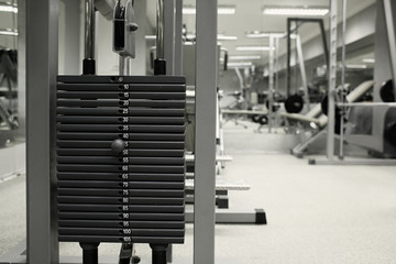 Exercising equipment at the gym, on blurred background