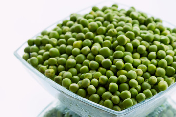 Green peas in glass bowl