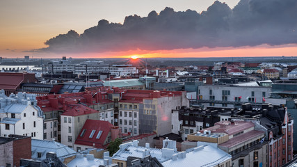 Helsinki rooftops at Sunset with dark clouds. Aerial view of Design District Helsinki, Finland.