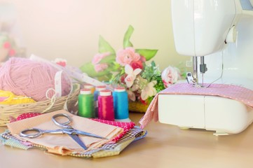 Sewing machine on the table with accessory for sewing