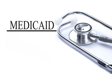 Page with medicaid on the table with stethoscope, medical concep