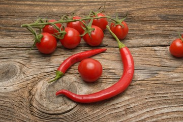 Wall Mural - Chilli and tomato on wood background