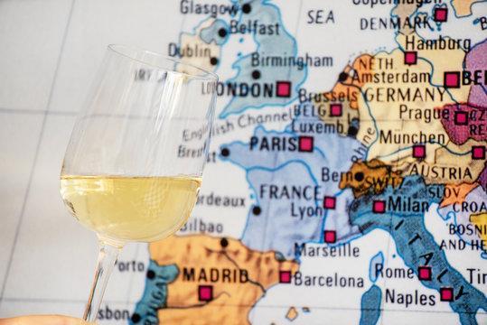 glass of wine near map