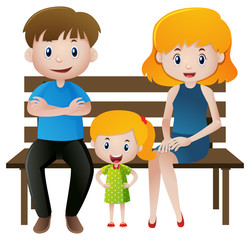 Parents and girl sitting on wooden bench