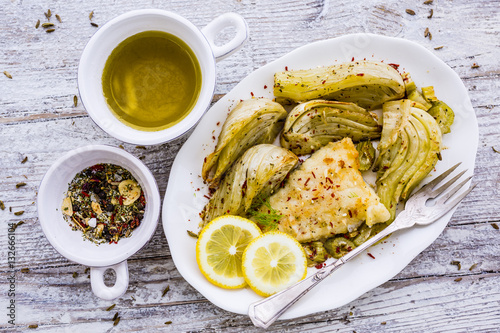 Baked fennel with herbs and olive oil served with fried for Frying fish in olive oil