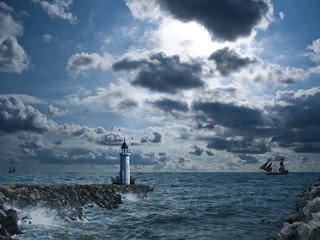 Lighthouse under the storm with ships in background