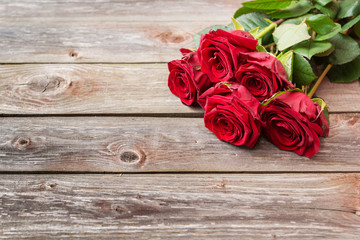 bouquet of red roses on wood background. Valentines Day backgrou