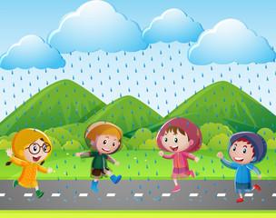 Four kids running in the rain