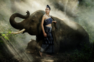 Beautiful asian woman and elephant with Thai culture traditional dress.