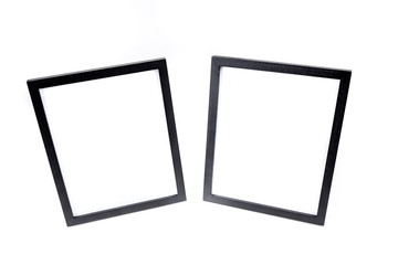 Two black picture frames isolated on a white background