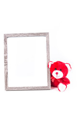 Valentine bear with a grey picture frame isolated on a white background