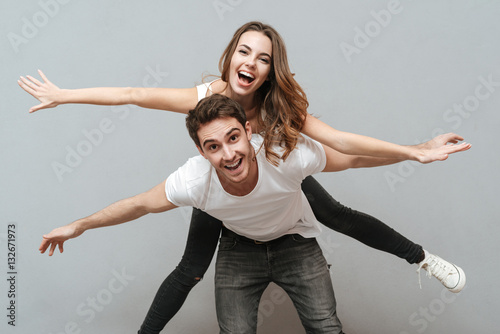 """Funny Young Couple Posing In Studio"" Stock Photo And"