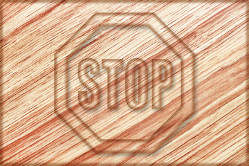 stop sign on wooden board