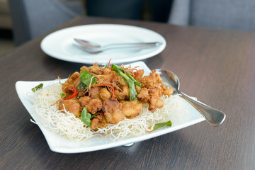 Fried chicken with crispy noodles.