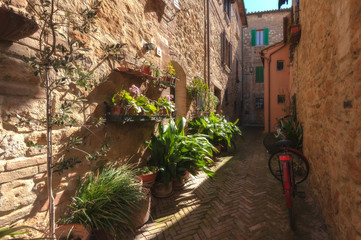 The red bike, in the Italian alley, in the Tuscan town