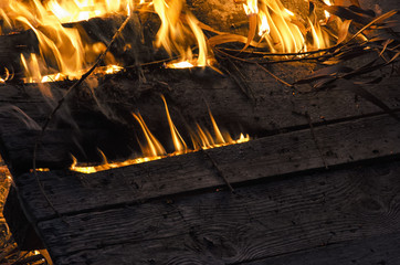 Wooden board engulfed in flames