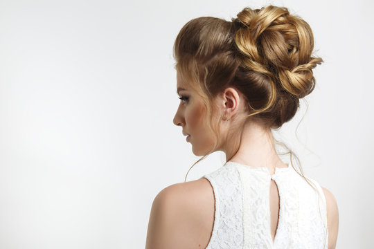 Elegant wedding hairstyle on a beautiful bride in profile.