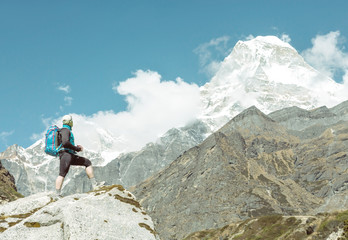 Person travelling in Mountains daylight soft tone with copy space