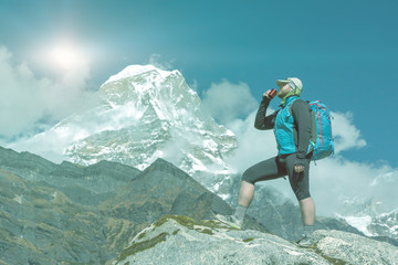 Man drinking Refreshment in high altitude Mountains soft toned