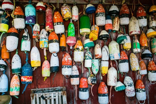 colored fishing floats on wooden wall