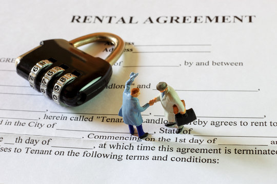 The little gentlemen are making commitment on rental agreement contract.