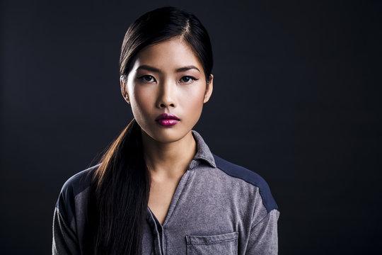 Beautiful Young Asian Woman Being Serious