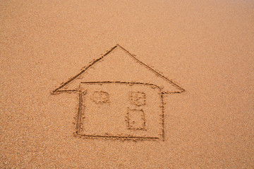 painted home on sand of beach