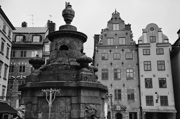 Statue with water outlets at Stortorget, Stockholm, Sweden