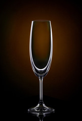 Empty wine glass on dark red