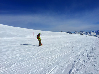 Mountain day winter. Elbrus. Snowboard.