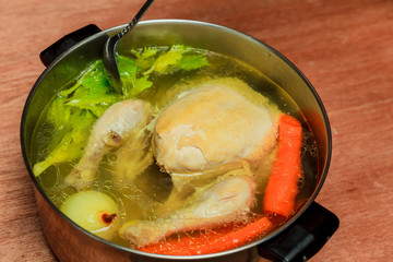 Boil chicken in the pot