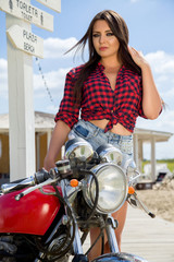Biker Girl on Retro Motorcycle