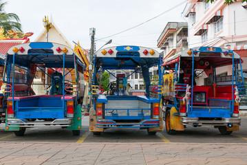 Blue funny rickshaws (tuk tuk) lined up in the street of Bankok, Thailand. Rear view.