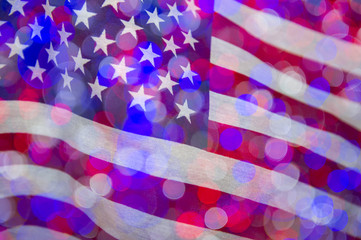 Colorful bokeh lights overlaid on American flag waving in celebration