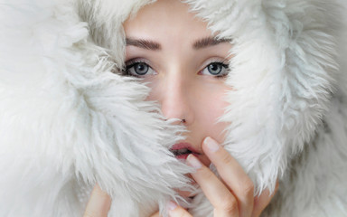 girl wrapped in white fur