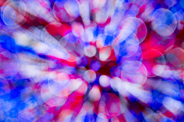 Colorful abstract background made from bokeh light bubbles in red, white, and blue,