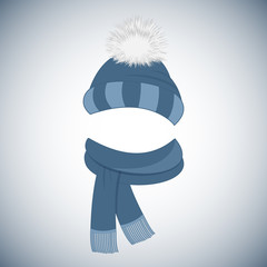 Winter blue cap with a pompom and a scarf with fringe