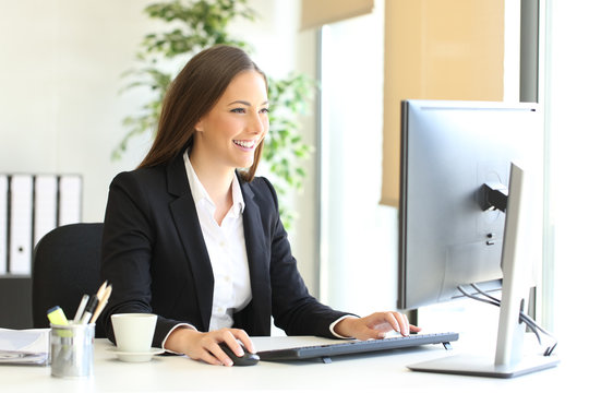 Executive working with a desktop computer