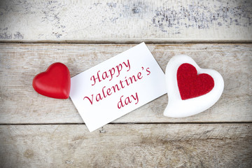 """Valentine greeting card on wooden table with text """" Happy Valentine's day"""""""