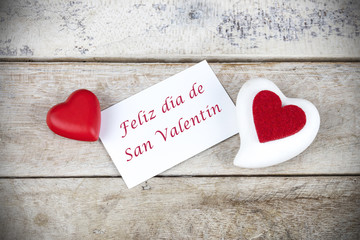 Valentine greeting card on wooden table with text written in spa