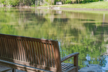 Peaceful spot to sit and relax.  Park bench with lake.