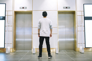 Man in hat standing near the elevator