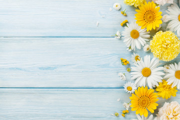 Garden flowers over wooden background