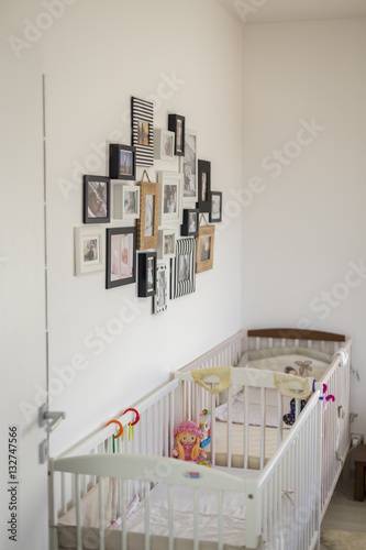 Wall mural bedroom with photos in various photo frame